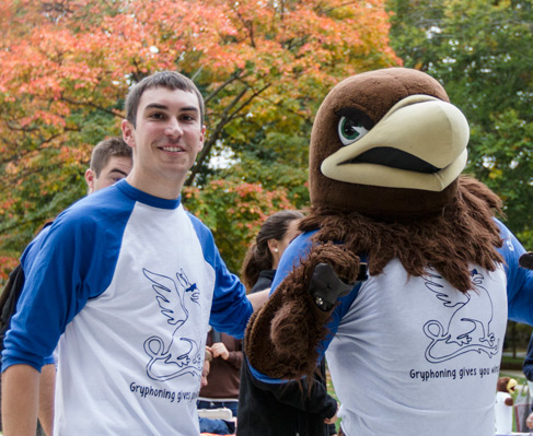 A Lehigh student with Clutch, Lehigh's mascot