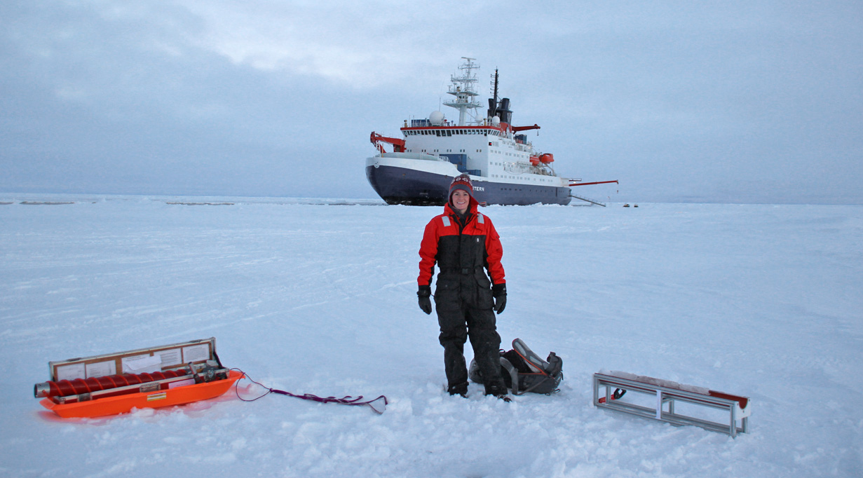 McDermott collecting ice core samples from arctic glaciers in front of the Polarstern, a German icebreaker belonging to the Alfred Wegener Institute for Polar and Marine Research (AWI).