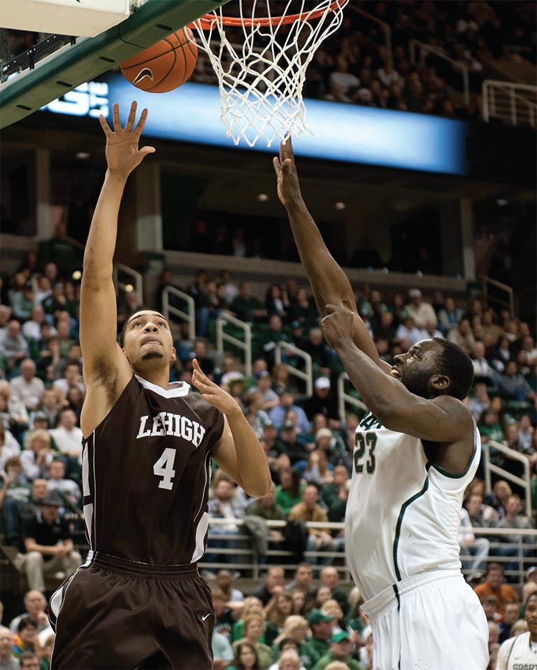 Lehigh basketball player John Adams shooting a layup