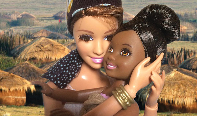 two barbies hugging eachother