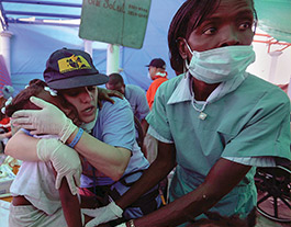 medical workers helping injured person