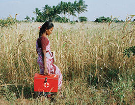 medical worker walking through field