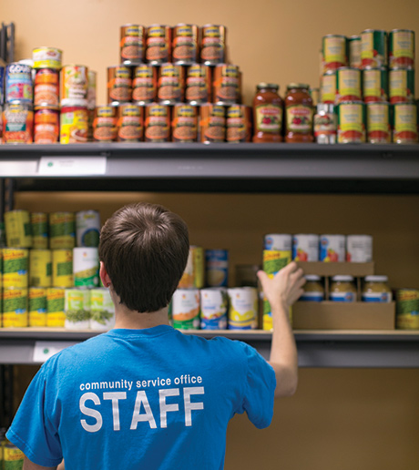 Student working in a food bank