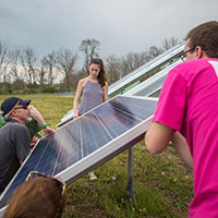 Lehigh University students and faculty installing solar panels near the Community Garden
