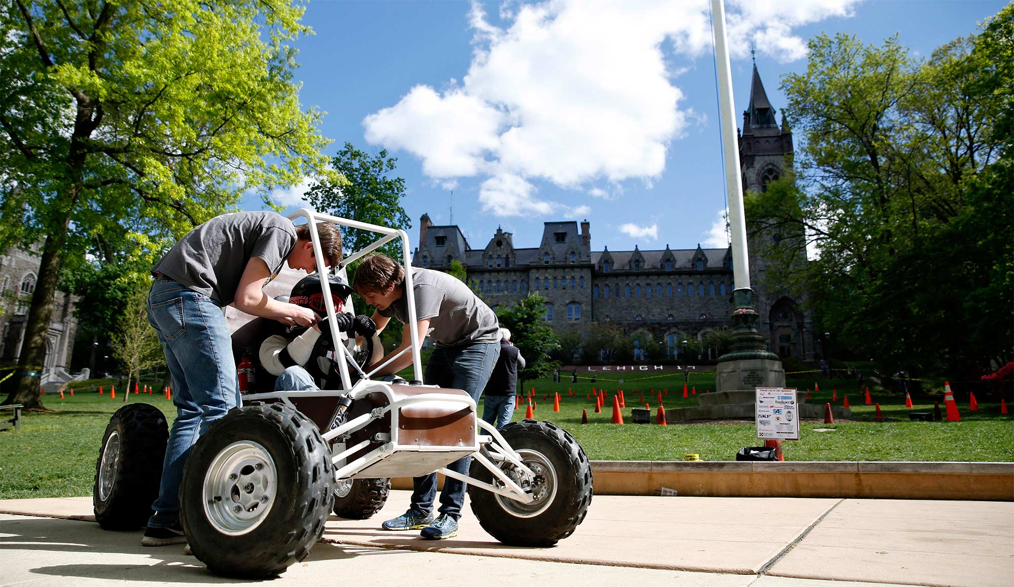 Baja race car maintenance on UC front lawn