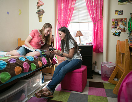 Two female students in a residence hall