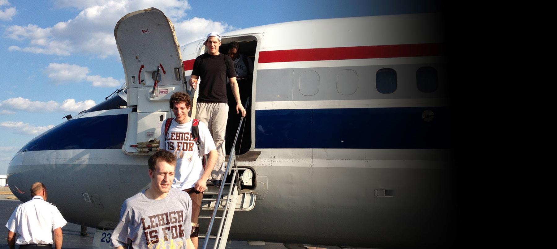 Lehigh University basketball players getting off plane