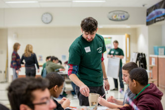 Graduate student assists middle schoolers at Lehigh University's annual BioFair.