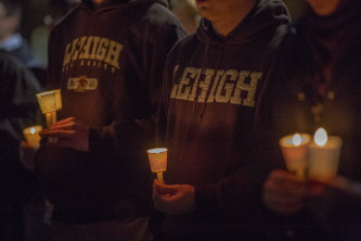 "Students held candles to ""illuminate the hope"" for a just and peaceful world."