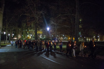 The vigil concluded with students walking in silence around University Lawn.