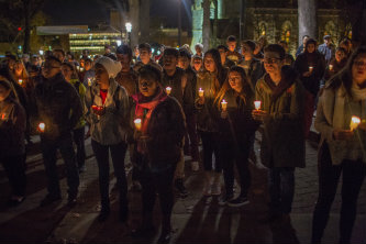 About 250 students gathered in front of the UC lawn for the 45-minute vigil.