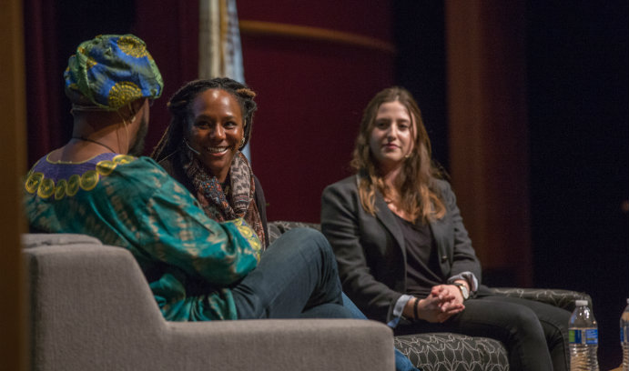 Activist and filmmaker Bree Newsome, center, talks with Darius Omar Williams, left, professor of theatre and Africana Studies, and Madeleine Centrella '81 at Baker Hall in the Zoellner Arts Center.