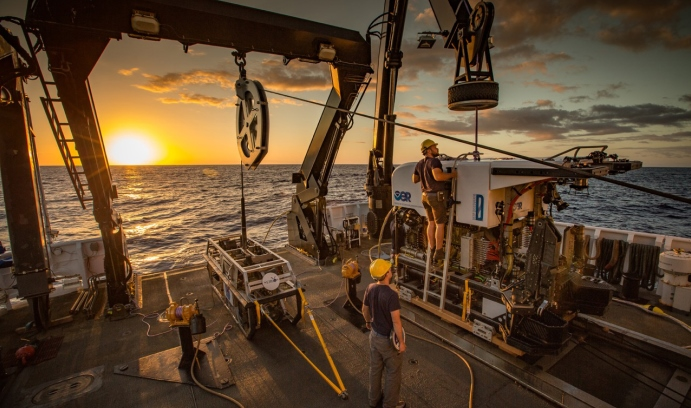 Remotely operated vehicles are prepared for deployment on the Okeanos Explorer. Powerful lighting, HD imaging and sensors collect in situ data on underwater environments. (Image courtesy of NOAA Office of Ocean Exploration and Research)