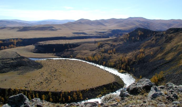 While studying the high topography of central Mongolia, Meltzer took this photograph of the flows of basaltic lava in the Chuluut River.