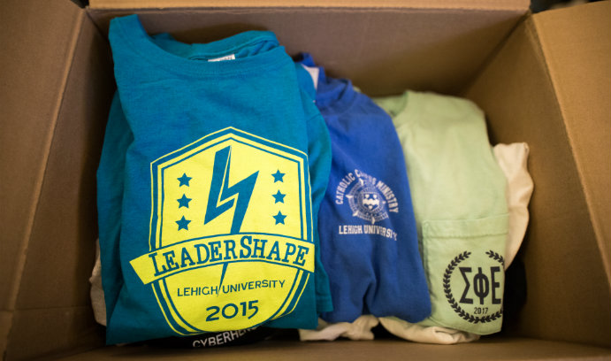 T-shirts in a cardboard box for Lehigh's Great South Side Sale.