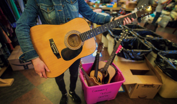 Image of woman holding a Martin guitar for Lehigh's Great South Side Sale