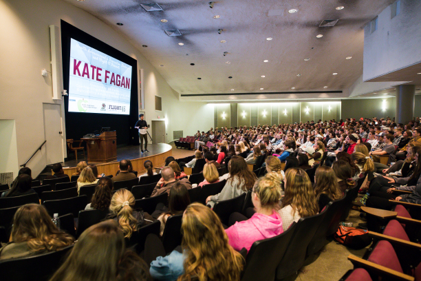 Kate Fagan stands on stage at Lehigh University