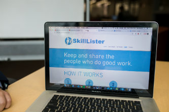 Laptop with screen showing SkillLister website