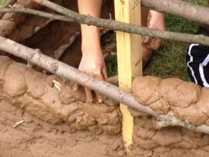 A mud adhesive forms the walls of the hut. Photo courtesy of Breena Holland