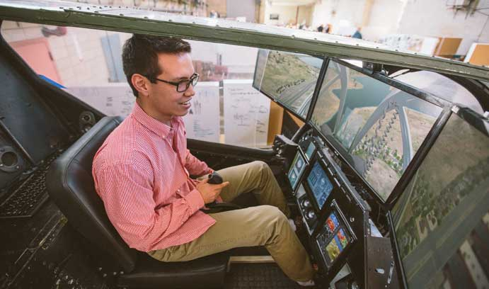 Kyle Lum '15 tries out the helicopter flight simulator