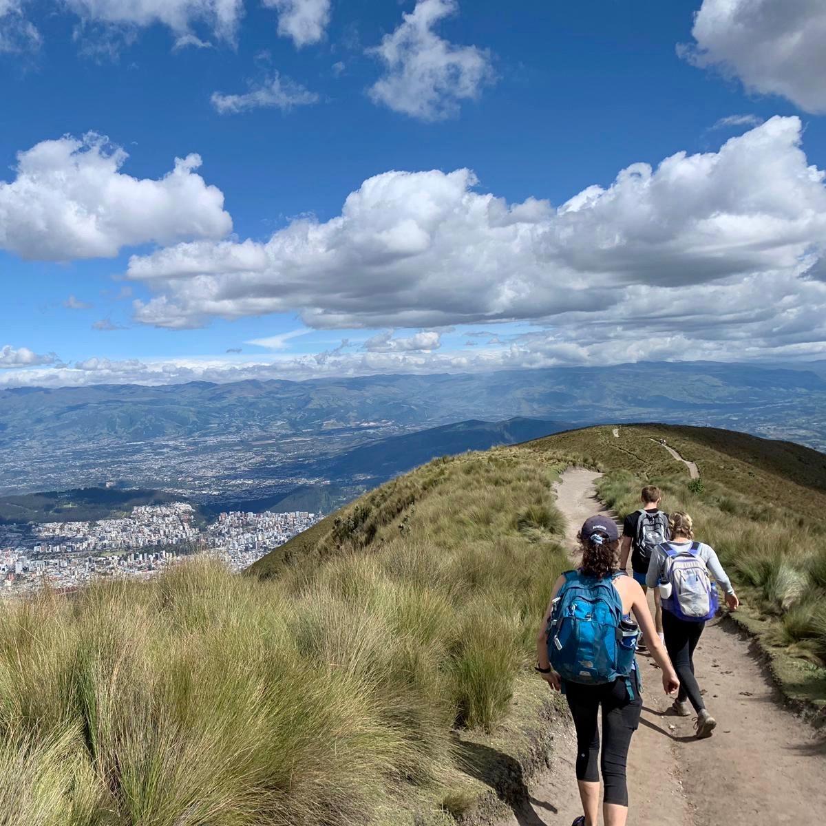 Three people hiking on a path