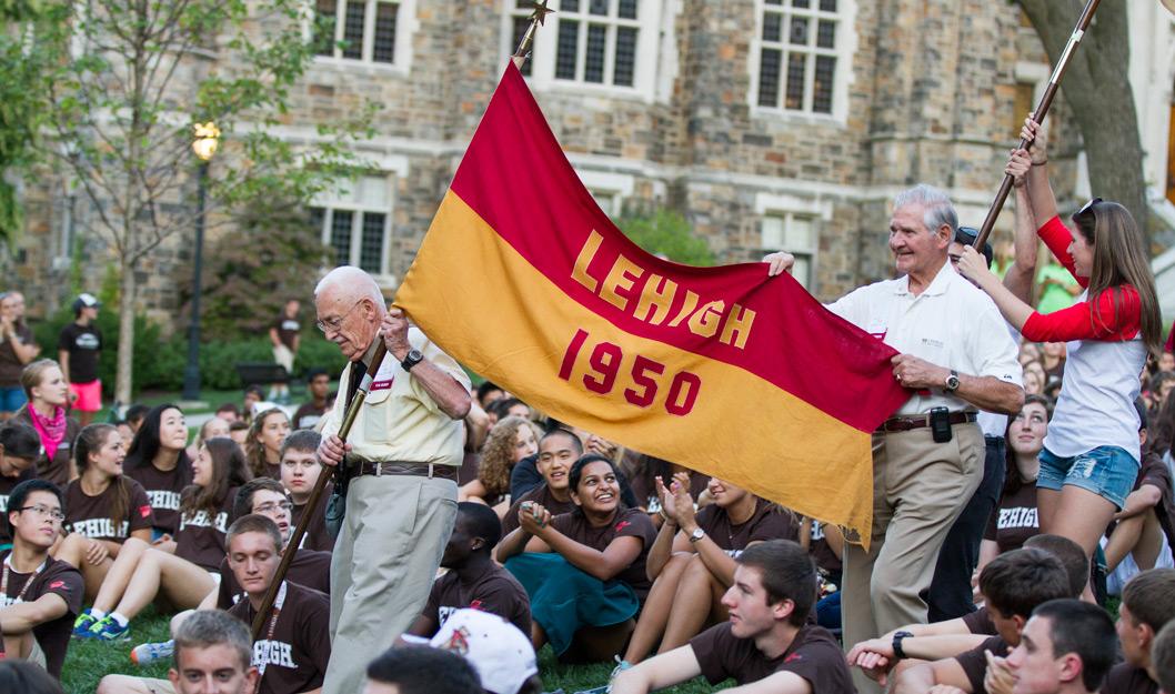 Alumni holding a Lehigh 1950 flag