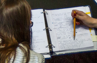 Student reading from a notebook