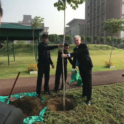 John Simon participating in a ceremonial tree planting