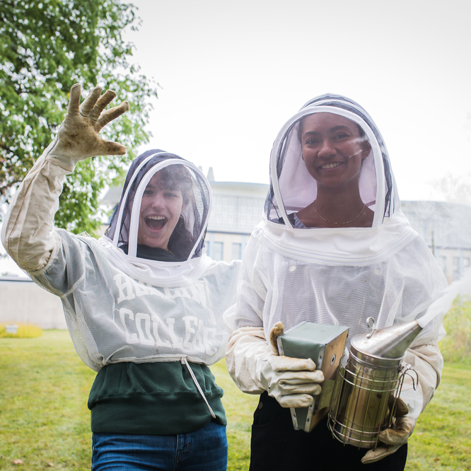 Two students in beekeeping outfits