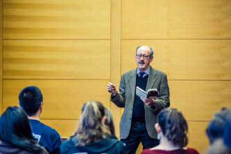 Billy Collins speaking to students