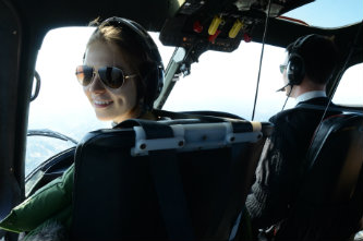 Voronetskaya is making memories as she travels around England. Above, she enjoys a helicopter flight over London.