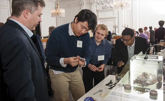 Guests look at student projects in computer science and engineering