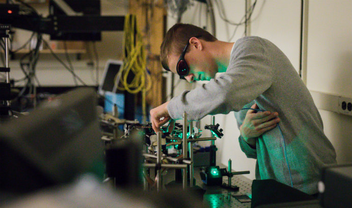 Lehigh undergraduate student Eric Wolf working in physics lab