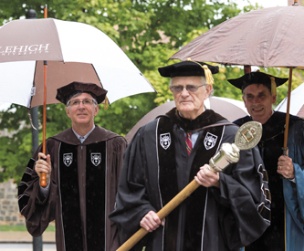 McIntosh leads the Founder's Day procession.