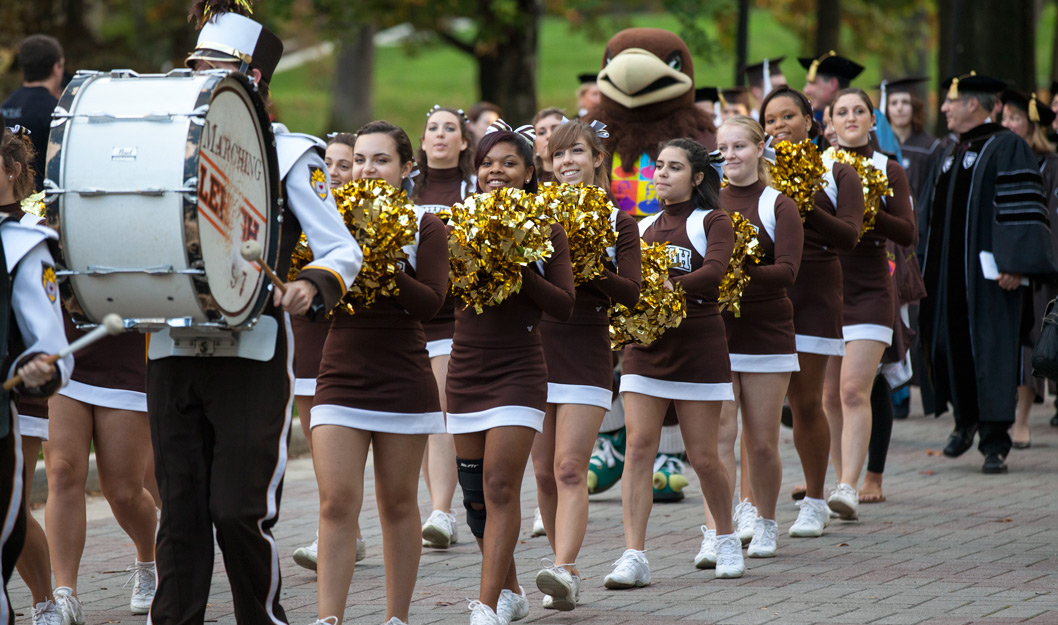 A procession of The Marching 97, Lehigh cheerleaders and university leadersihp