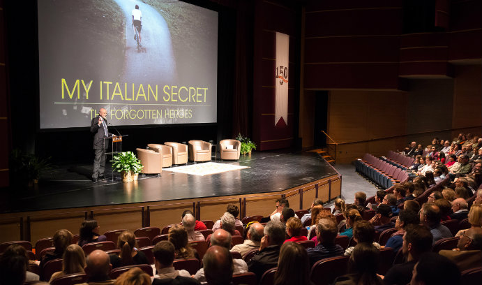 Joseph R. Perella '64 '06H, executive producer of the documentary My Italian Secret: The Forgotten Heroes, welcoming the Baker Hall audience to the screening