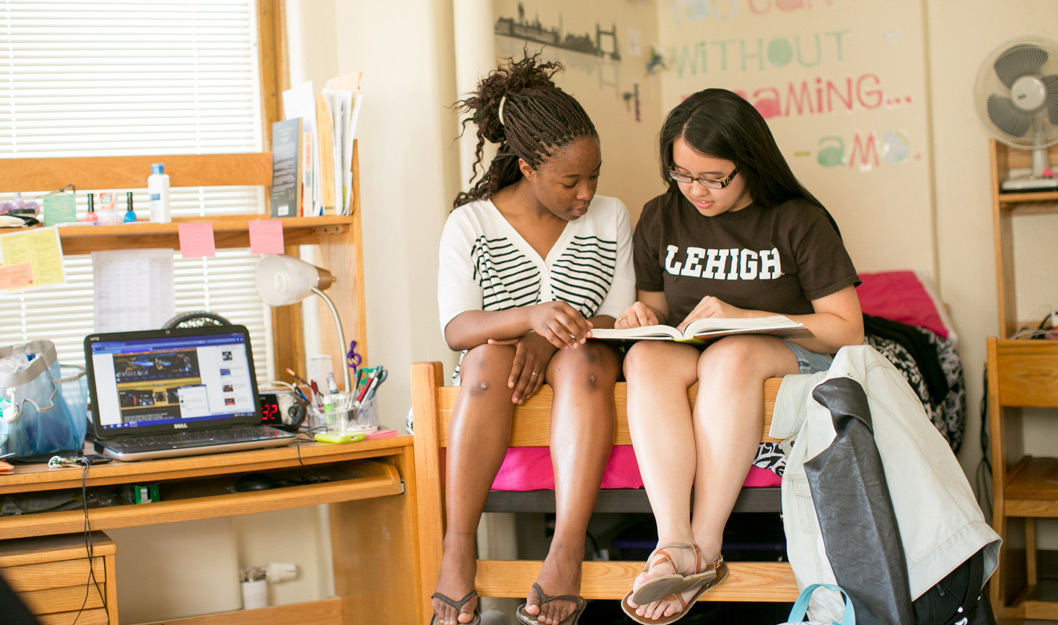 Two students reading in a dorm room