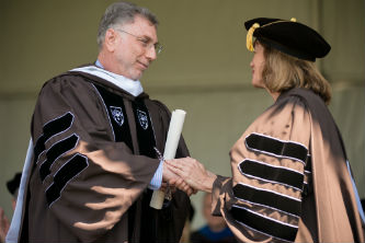 "Commencement speaker Martin ""Marty"" Baron '76 is greeted by Lehigh President Alice P. Gast."