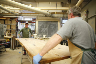 Mechanical engineering student John Obiedzinski takes pride in building the conference tables for Williams Hall, knowing they will endure for generations.