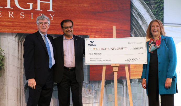 Sanjay Shah '89 presents a symbolic check to Lehigh President John D. Simon '19P and Georgette Chapman Phillips, the Kevin L. and Lisa A. Clayton Dean of the College of Business and Economics
