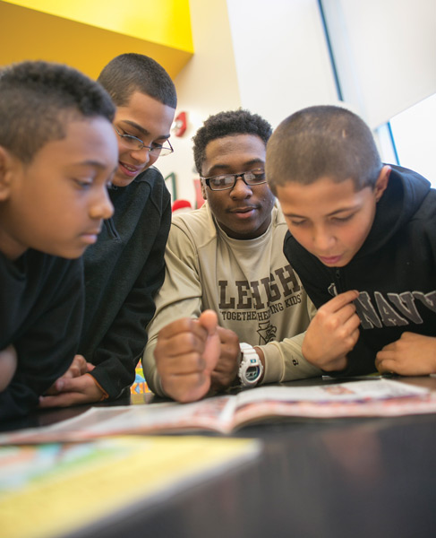 Lehigh student reading with children