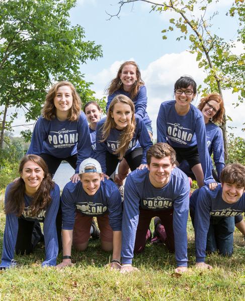 Group of students forming a human pyramid