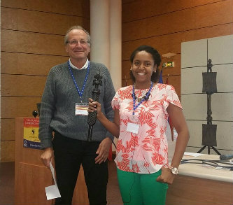 From left, Dr. Paul Dumas, of the SOLEIL synchrotron facility near Paris, France, and Krystle McLaughlin, professor of practice in Lehigh's department of biological sciences.McLaughlin, pictured prior to her talk, is holding a traditional African speaking