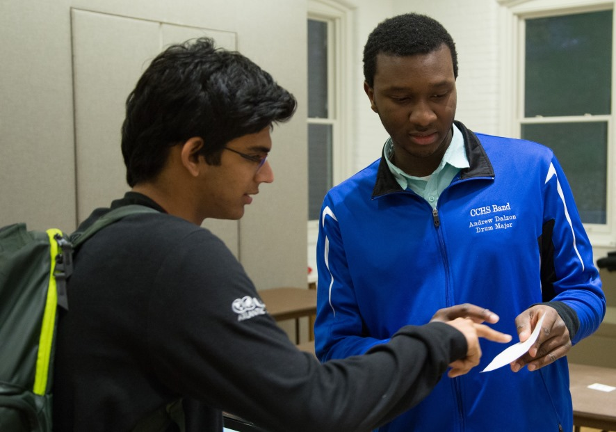 Andrew Dalzon '19, a CSB major, shows a visitor how StockVise works