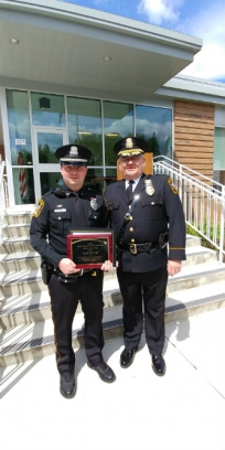 Officer Drew Devery, left, was presented with the LUPD Officer of the Year Award by Chief Ed Shupp.