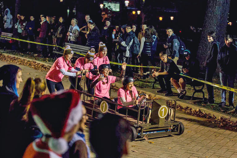 Students participating in bed races