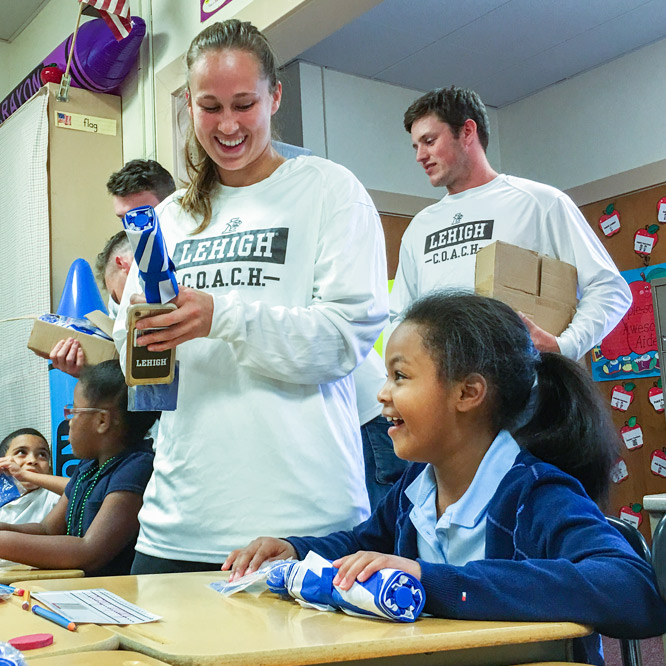 The Community Outreach by Athletes who Care about Helping (C.O.A.C.H.) program allows student-athletes to engage with children in local schools.