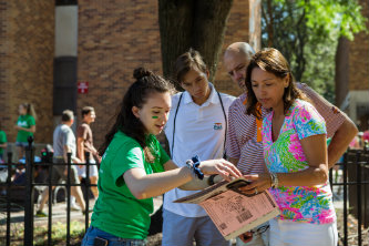 A family gets directions from a volunteer on Lehigh University's move-in day