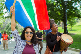 Lehigh Mandela Fellows participate in a flag parade on Mandela Day