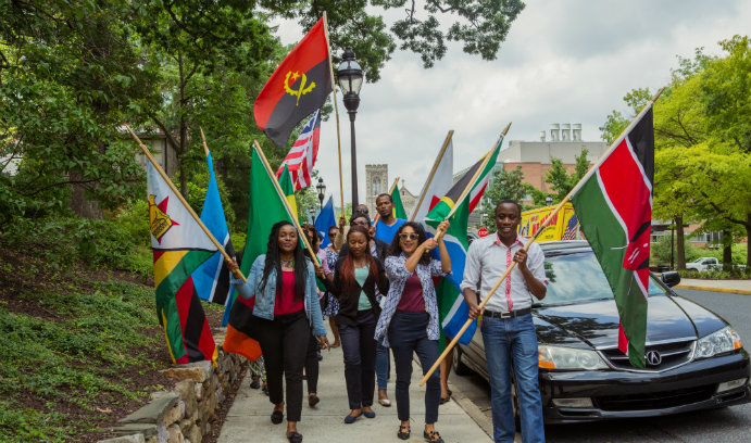 Mandela Fellows at Lehigh University participate in flag parade at Mandela Day celebration.